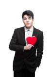 Hombre joven de los asuntos divertidos el el día de tarjeta del día de San Valentín Fotografía de archivo