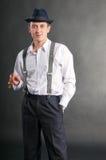 Hombre joven del gángster con el cigare Fotografía de archivo libre de regalías