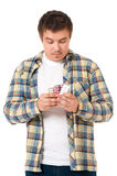 Hombre joven deprimido que toma píldoras Fotografía de archivo libre de regalías