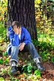 Hombre joven doloroso Imagenes de archivo