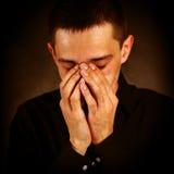 Hombre joven doloroso Fotos de archivo