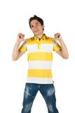 Hombre joven en camiseta y pantalones vaqueros Fotos de archivo