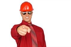 Hombre joven en casco protector rojo Imagen de archivo