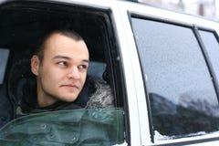 Hombre joven en coche Fotos de archivo