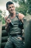 Hombre joven en el campo de batalla Imágenes de archivo libres de regalías