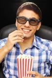 Hombre joven en el cine Fotografía de archivo libre de regalías