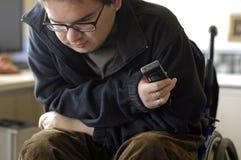 Hombre joven en el sillón de ruedas Imagen de archivo