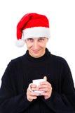 Hombre joven en el sombrero de santa Imagen de archivo libre de regalías