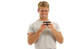 Hombre joven en el teléfono celular Imágenes de archivo libres de regalías