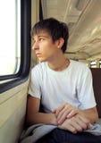 Hombre joven en el tren Imagenes de archivo