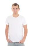 Hombre joven en la camiseta blanca aislada Fotografía de archivo libre de regalías