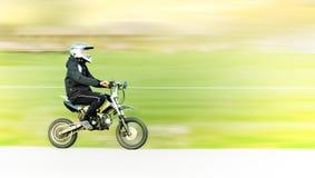 Hombre joven en la moto Foto de archivo libre de regalías