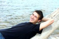 Hombre joven en la playa Foto de archivo