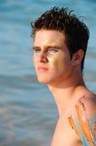 Hombre joven en la playa Foto de archivo libre de regalías