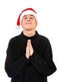 Hombre joven en la rogación de Santa Hat Imágenes de archivo libres de regalías
