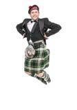 Hombre joven en la ropa para la danza del escocés Fotos de archivo