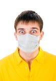 Hombre joven en máscara de la gripe Imagen de archivo