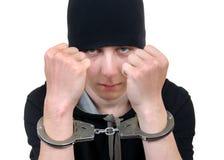 Hombre joven en manillas Imagen de archivo libre de regalías