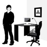 Hombre joven en oficina Fotos de archivo