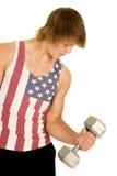 Hombre joven en peso del rizo del top sin mangas de la bandera Foto de archivo libre de regalías