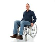 Hombre joven en silla de ruedas Fotos de archivo libres de regalías