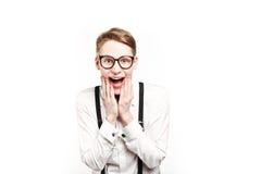 Hombre joven en sorpresas y choque de los vidrios Fotos de archivo libres de regalías