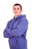 Hombre joven en sudadera con capucha Foto de archivo