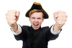 Hombre joven en traje con el sombrero del pirata aislado encendido Imagen de archivo
