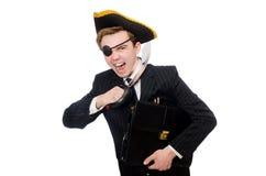 Hombre joven en traje con el sombrero del pirata aislado encendido Fotografía de archivo libre de regalías