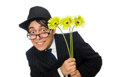 Hombre joven en traje negro con la flor fotografía de archivo