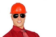 Hombre joven en un casco protector Fotos de archivo libres de regalías