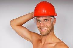 Hombre joven en un casco protector y anteojos Imagen de archivo