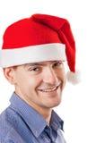 Hombre joven en un sombrero de Santa Imagenes de archivo