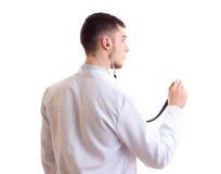 Hombre joven en vestido del doctor Imágenes de archivo libres de regalías