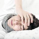 Hombre joven enfermo Fotografía de archivo