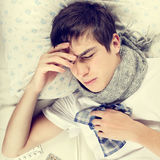 Hombre joven enfermo Foto de archivo