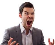 Hombre joven enojado que grita Imagen de archivo