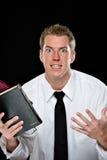 Hombre joven entusiasta que sostiene las biblias Imágenes de archivo libres de regalías