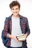 Hombre joven feliz con el morral Fotos de archivo libres de regalías