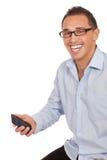 Hombre joven feliz con el teléfono móvil Imagenes de archivo