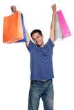 Hombre joven feliz con los panieres Foto de archivo libre de regalías