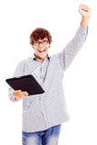Hombre joven feliz con PC de la tablilla Fotos de archivo libres de regalías