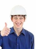 Hombre joven feliz en casco Foto de archivo