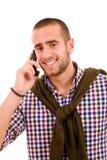 Hombre joven feliz en el teléfono Foto de archivo libre de regalías