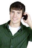 Hombre joven feliz en el teléfono celular Imagen de archivo