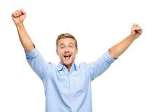 Hombre joven feliz que celebra éxito en el fondo blanco Imagen de archivo libre de regalías