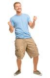 Hombre joven feliz que celebra el éxito aislado en blanco Foto de archivo libre de regalías