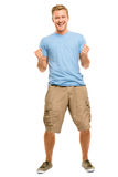Hombre joven feliz que celebra el éxito aislado en blanco Fotografía de archivo