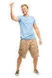 Hombre joven feliz que celebra el éxito aislado en blanco Imagen de archivo libre de regalías