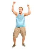 Hombre joven feliz que celebra el éxito aislado en blanco Fotografía de archivo libre de regalías